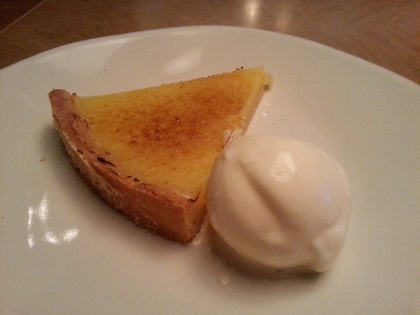 Warm lemon tart with clotted cream ice cream